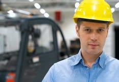 Warehouseman. Warehouseman in yellow hard hat at warehouse Stock Photos