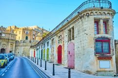 Warehouses with colorful doors, Valletta, Malta royalty free stock images
