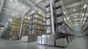 Warehouses large logistics commerce structure with boxes on the shelf. Teamwork male person industry production, using machine work and vehicle, delivering stock video
