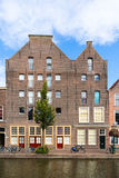 Warehouses on Old Rhine canal in Leiden, Netherlands Royalty Free Stock Images