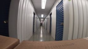 Warehouses for storage. Large trolley with cardboard boxes, metal gates