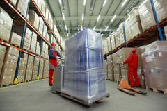Warehousing  optimization  - people at work Stock Image