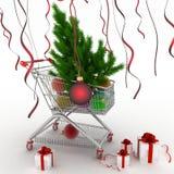 Warenkorb voll mit Weihnachtsbällen mit Tannenbaum und Geschenkboxen Stockfotografie
