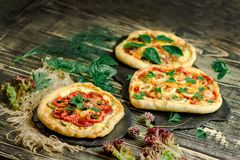 Wariety pizza on wooden board and various ingredients stock photo
