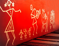 Warli painting. On the orange wall Stock Photos