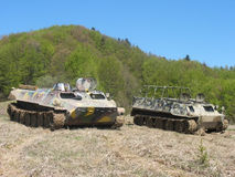 Warlike equipment. Military vehicles staying in ukrainian mountains Stock Image