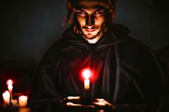 Evil sorcerer with a candle stock photography
