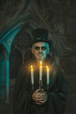 Warlock male with a candelabra in hand. Royalty Free Stock Image