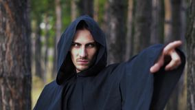 Warlock pointing finger. The black monk pointing his finger in the woods stock video