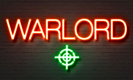 Warlord neon sign on brick wall background. Royalty Free Stock Photo