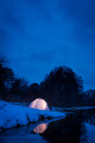 Warm accommodation in a cold snowy night Royalty Free Stock Photos