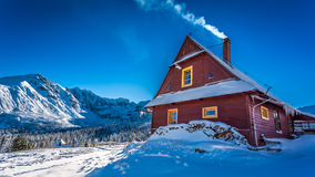 Warm accommodation in cold winter mountains Royalty Free Stock Photos