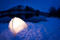 Warm accommodation in the cold winter night Stock Photography