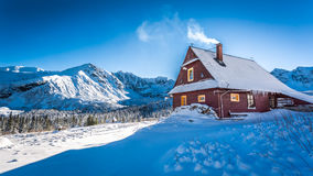 Warm accommodation in a mountain cottage in winter Stock Photo