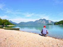Warm afternoon in soft green and blue light and canoe in lake. Mountain range royalty free stock photography