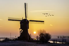 Warm And Frozen Windmill Sunrise Stock Photo