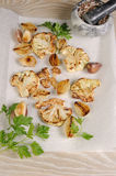 Warm appetizer of fried pieces of cauliflower with garlic and on Stock Image