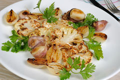 Warm appetizer of fried pieces of cauliflower with garlic and on Royalty Free Stock Image