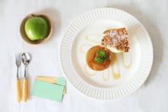 Warm apple tart with vanilla ice cream. And fresh apple Royalty Free Stock Photography