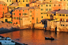 Warm atmosphere in Boccadasse. Golden hour in Boccadasse, a small sea district of Genoa (northern Italy Royalty Free Stock Images