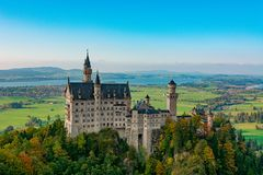 Neuschwanstein castle with with many shades of greens and browns due to the autumn season stock images