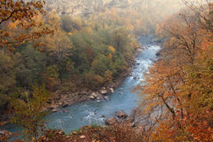Warm autumn landscape of vast forest territory with rapid mountain river. Top point view Stock Photo