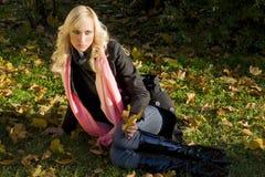 Warm autumn portrait of girl sitting Royalty Free Stock Photos