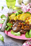 Warm autumn salad chard leaves,chicken liver,caramelized pear an. D raisins on a grey concrete or stone background Royalty Free Stock Images