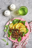 Warm autumn salad chard leaves,chicken liver,caramelized pear an Royalty Free Stock Photos
