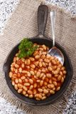 Warm baked beans in tomato sauce served in a cast iron pan Stock Photos
