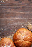 Warm baked bread, tasty crunchy buns, healthy food on dinner table, with text space Royalty Free Stock Images