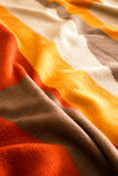 Warm bed sheet background. Colorful Texture Royalty Free Stock Image
