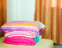 Warm bedroom with comforter and big fluffy pillow on the bed. Royalty Free Stock Photography