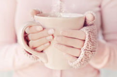 Warm beverages. Woman holding warm tea cup Stock Photos