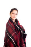 Warm blanket cover pretty girl isolated. On white Royalty Free Stock Photo