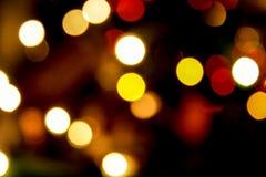 Warm Blurred light, bokeh effect. Warm blurred defocused light of christmas tree Royalty Free Stock Photos
