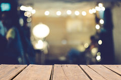 Warm bokeh blurred background on brown wooden table Stock Photo