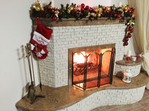 Warm, bright, cozy fire burning fireplace in the home Stock Images