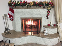 Warm, bright, cozy fire burning fireplace in the home Stock Photos