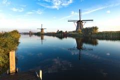 Warm and Calm windmill sunrise Stock Photo