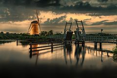 Warm and Calm windmill sunset stock photo