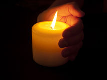 Warm Candle in Cupped Hand Stock Image