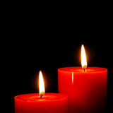 Warm candles. Portrait of warm red candles - seasonal or religious feeling Stock Images