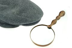 Warm Cap with Earflaps and Magnifying Glass Royalty Free Stock Photo