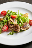 Warm Chicken Liver Salad. Restaurant and Gourmet Food - Warm Chicken Liver Salad with Mushrooms, Asparagus and Cherry Tomato Royalty Free Stock Photography