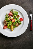 Warm Chicken Liver Salad. Restaurant and Gourmet Food - Warm Chicken Liver Salad with Mushrooms, Asparagus and Cherry Tomato Royalty Free Stock Photos
