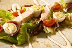 Warm chicken salad. With quail eggs dressed with balsamico Stock Images