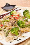Warm Chinese salad with rice noodles Stock Images