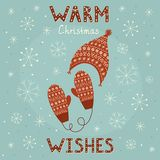 Warm Christmas wishes card with cozy mittens and cap. Vector illustration Stock Images