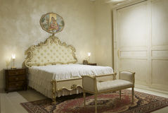 Warm classical bedroom Stock Images